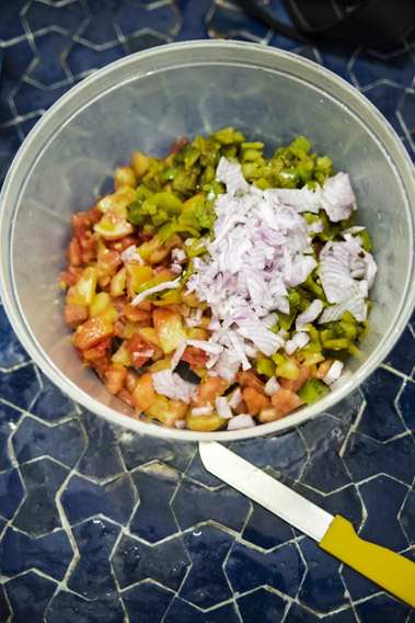Traveling in Marocco in Africa / Essaouira: Preparing the salad for the Tajine