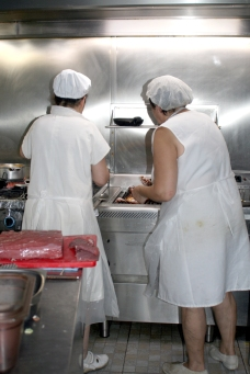 The cooks working in the kitchen